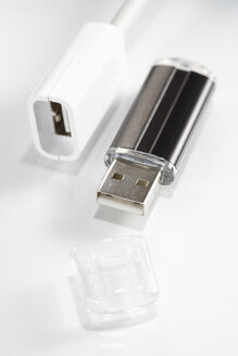 Plug and USB flash drive on white background, elevated view - JRF00043