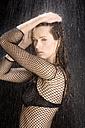 Young woman in bikini having a shower, portrait - MAE01037