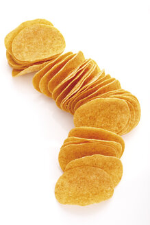 Potato chips in a row, elevated view - 09072CS-U