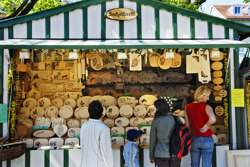 Germany, Bavaria, Munich, Auer Dult, traditional market, Market stand with wooden souvenirs - MB00872