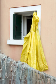 Italy, Venice, Burano, Raincoat and fishing net - AWDF00047