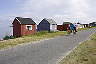 Denmark, Mountainbikers riding across coastal highway - DSF00186