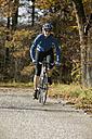 Germany, Bavaria, Oberland, Woman mountain biking - DSF00024