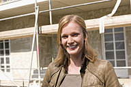 Woman in front of her New House, smiling, portrait - WESTF09128