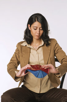Young woman holding purse, portrait - NHF00929