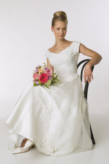 Young bride sitting on chair, portrait - NHF00916