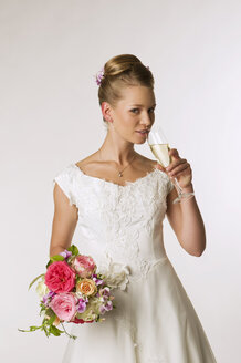 Young bride drinking champagne, portrait - NHF00896