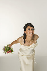 Young Bride Throwing Bouquet - NHF00846