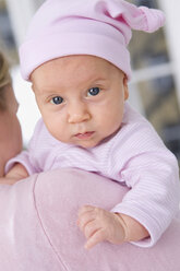 Baby girl (2 months) being carried, portrait - SMO00296