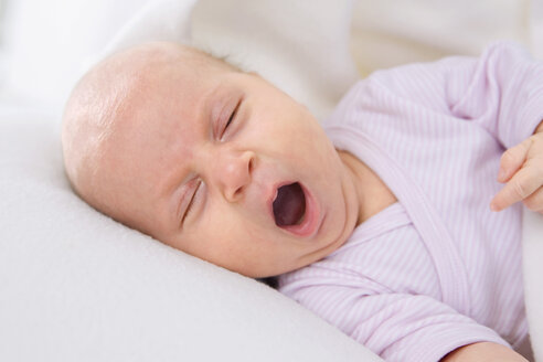 Baby girl (2 months) yawning, portrait - SMO00284