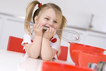 Little girl (3-4) holding eggbeater, portrait - SMO00224