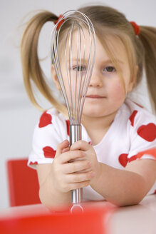 Little girl (3-4) playing with eggbeater and bowl - SMO00221