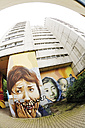 Germany, Berlin, Town building, house front decorated with painting graffiti, low angle view - 00368DH-U