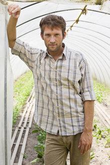 Man in greenhouse, portrait - BMF00419