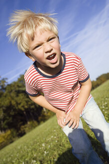 Little boy (4-5) fooling about, portrait - SMO00269