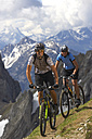 Germany, Bavaria, Karwendel, Couple mountain biking - MRF01105