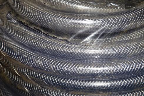 Coiled metal tubing, (full frame), close-up - AWDF00231