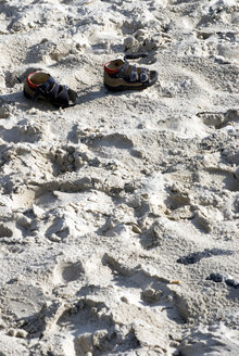 Germany, Amrum, Children's shoes in the sand - AWDF00087