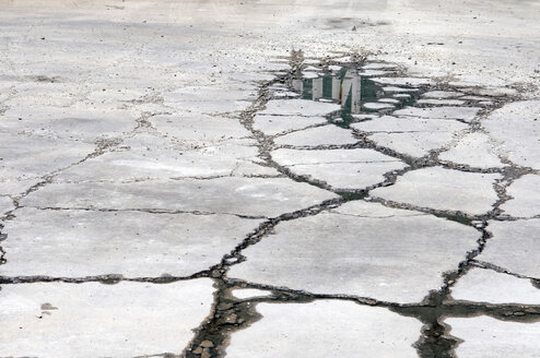 Cracks and puddle in asphalt - AWD00333