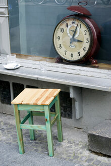 Germany, Berlin, Giant clock in shop window - AWD00321
