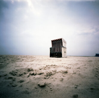 Germany, North Sea, Amrum, Roofed wicker beach chair on the beach - AWD00300
