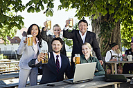 Germany, Bavaria, Upper Bavaria, Young business people in beer garden, portrait - WESTF09713