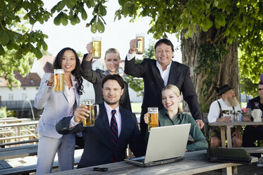 Germany, Bavaria, Upper Bavaria, Young business people in beer garden, portrait - WESTF09713