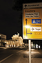 Germany, Berlin, Brandenburger Tor at night, road sign in foreground - 00454DH-U