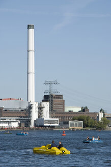 Germany, Berlin, Pedal boats on Spree river, Power station in the background - PM00731