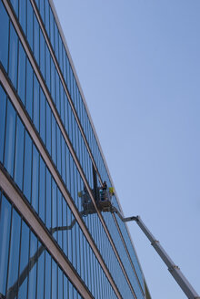 Germany, Berlin, Office building, glass front, window cleaner - PM00692