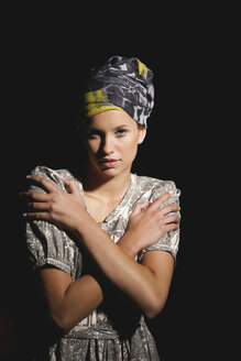Young woman wearing head scarf, portrait - OW00875