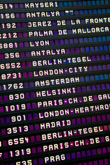 Flight arrival and departure board in airport, full frame - MUF00677