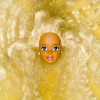 Plastic doll head, elevated view - MU00641
