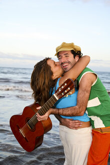 Spain, Canary Islands, Gran Canaria, Woman embracing man with guitar - PK00293