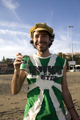Spain, Canary Islands, Gran Canaria, Young man holding beer can - PK00286