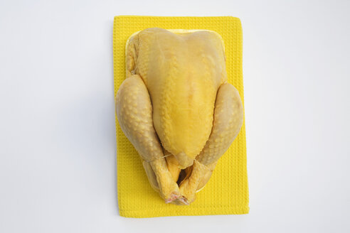 Raw chicken on dish towel, elevated view - GWF00861