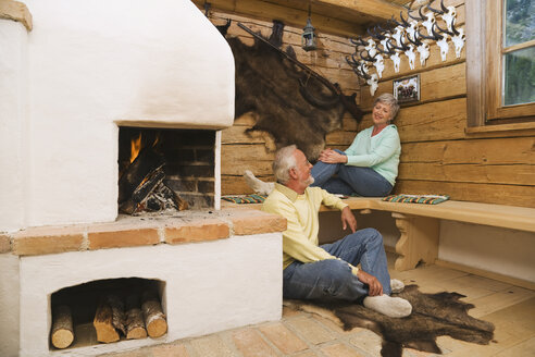 Senior couple in hunting lodge - WESTF10433