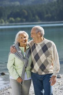 Germany, Bavaria, Walchensee, Senior couple on lakeshore, smiling - WESTF10116