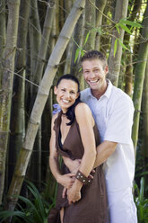 Young couple embracing smiling, portrait - ABF00486