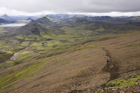 Iceland, Two Men mountain biking in hilly landscape - FF00990