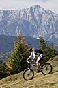 Austria, Salzburger Land, Zell am See, Woman mountain biking - FFF01024