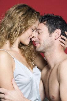 Young couple embracing, close-up - NHF00996
