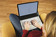 Young woman using laptop, elevated view, close-up - WWF00367