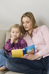 Mother and daughter (3-4) reading picture book - CLF00619