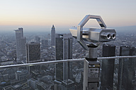 Germany, Frankfurt on the Main, Financial district, telescope in foreground - RUE00101