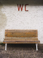 Austria, Salzburger land, bench in front of wall, WC sign - WWF00440