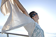 Greece, Ithaca, Young woman wearing sunglasses, smiling, portrait - MUF00775