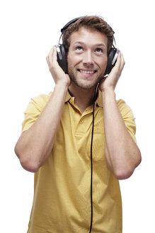 Young man wearing headphones, portrait - BMF00522