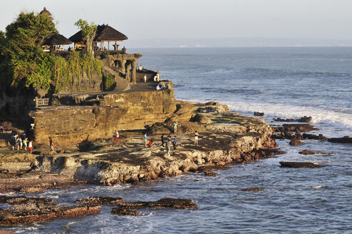 Indonesia, Bali, Tanah Lot Temple on offshore rock with tourists - MB00909