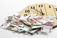Euro bank notes and clock, symbol for time is money - 10806CS-U